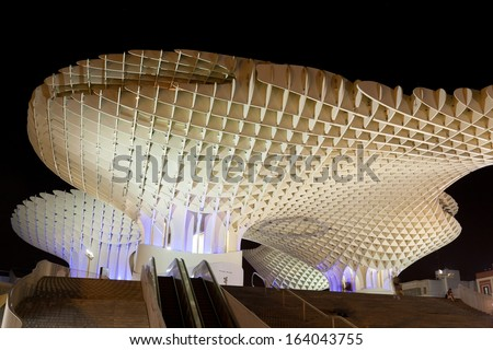 SEVILLA,SPAIN -SEPTEMBER 17 : Metropol Parasol in Plaza de la Encarnacion on September 02, 2013 in Sevilla, Spain. J. Mayer H. architects, it is made from bonded timber with a polyurethane coating. - stock photo