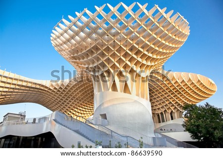 SEVILLA,SPAIN -SEPTEMBER 14: Metropol Parasol in Plaza de la Encarnacion on September 14, 2011 in Sevilla,Spain. J. Mayer H. architects, it is made from bonded timber with a polyurethane coating. - stock photo