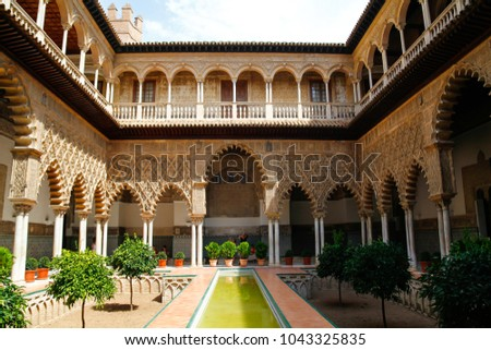 SEVILLA, SPAIN - SEPTEMBER 07, 2012: The Alcazar of Seville, a royal palace in Seville, Spain, originally developed by Moorish Muslim kings, registered as UNESCO World Heritage Site.