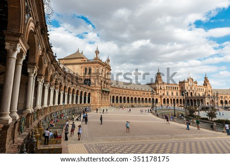 SEVILLA, SPAIN - SEPTEMBER 19: Wide-angle view of a crowded Plaza de Espana in Seville, Spain, a square built in 1928 for the Ibero-American Exposition, on September 19, 2015.