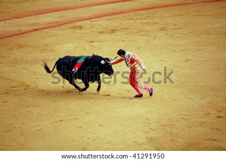 "SEVILLE - APRIL 30:  Bullfighter David Fandila ""El Fandi"" fights for a sold out crowd at the Plaza de Toros de Sevilla on April 30, 2009 in Seville, Spain."