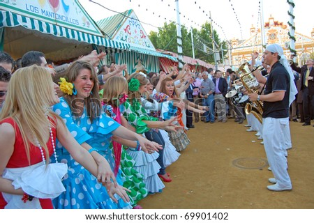 SEVILLE - APRIL 28: Spontaneous celebrations of music and dance erupt during the Feria de Abril on April 28, 2009 in Seville, Spain. - stock photo