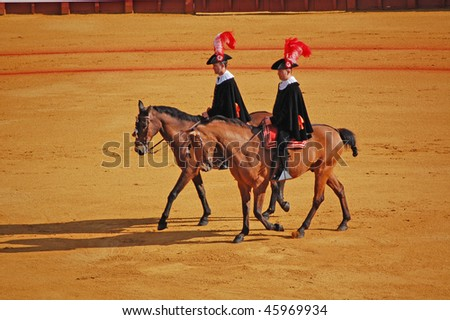 SEVILLE - APRIL 30: The horsemen at the beginning of the march into the bullfight at the Plaza de Toros de Sevilla April 30, 2009 in Seville, Spain. - stock photo