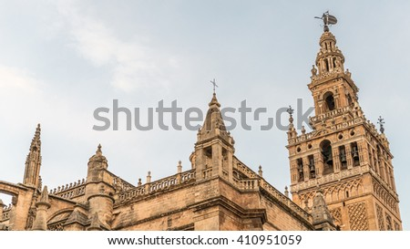 Seville cathedral with the Giralda tower in evening summer. The Cathedral of Saint Mary of the See (Seville Cathedral) in Seville, Andalusia, Spain - stock photo