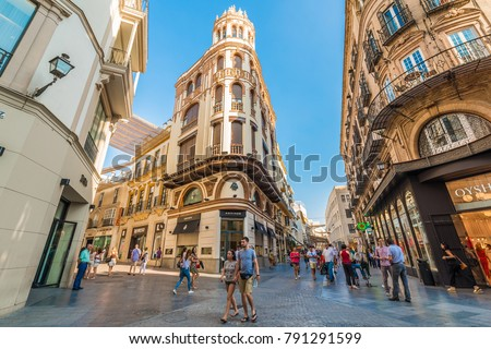 SEVILLE, ES - JULY 26, 2017: Calle Sierpes is a traditional and busy shopping street in the Spanish city of Seville, Andalusia, Spain.