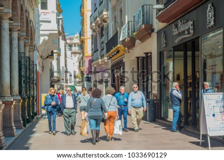 SEVILLE, ES - MARCH 9, 2017: Sierpes street is a traditional and busy commercial street of the Spanish city of Seville, Andalusia, Spain