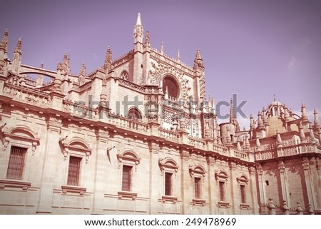 Seville in Andalusia, Spain. Famous cathedral. UNESCO World Heritage Site. Cross processed color tone - retro image filtered style. - stock photo