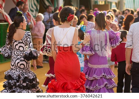 SEVILLE, SPAIN - APR, 25: women dressed in traditional costumes at the Seville's April Fair on April, 25, 2014 in Seville, Spain - stock photo