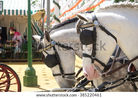SEVILLE, SPAIN - APRIL 23, 2015: Horse drawn carriage on the Fair of Seville on April, 23, 2015 in Seville, Spain