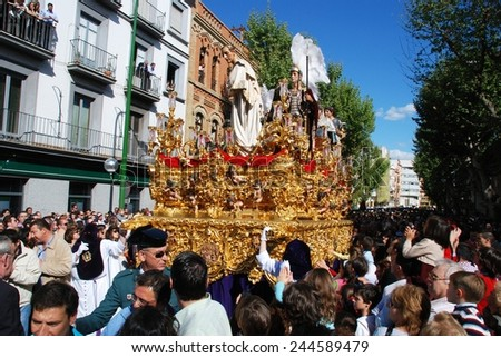SEVILLE, SPAIN - APRIL 7, 2009 - San Benito brotherhood float moving through the city streets during Santa Semana, Seville, Seville Province, Andalusia, Spain, Western Europe, April 7, 2009. - stock photo