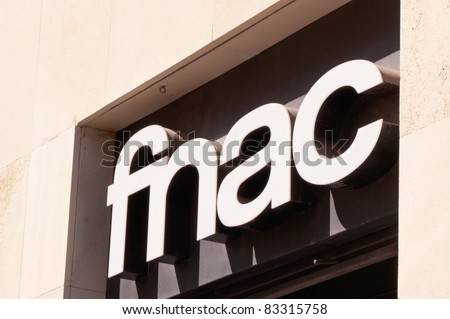 SEVILLE, SPAIN - AUGUST 16: Fnac neon shop sign on August 16, 2011 in Seville. Fnac was founded by by André Essel and Max Théret  in 1954 and is the largest electronic and cultural retailer in France.