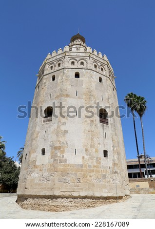 SEVILLE, SPAIN- AUGUST 27, 2014: Torre del Oro or Golden Tower (13th century), a medieval Arabic military dodecagonal watchtower in Seville, Andalusia, southern Spain
