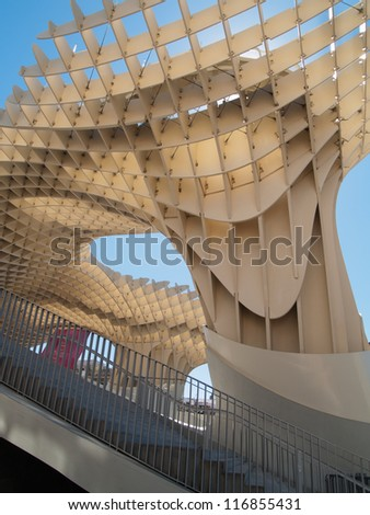 SEVILLE,SPAIN - JUNE 2012: Metropol Parasol in Plaza de la Encarnacion on June 2012 in Sevilla,Spain. J. Mayer H. architects, it is made from bonded timber with a polyurethane coating. - stock photo