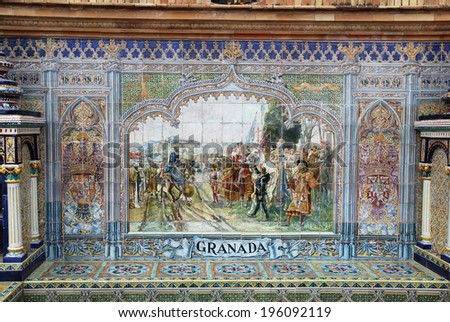 SEVILLE, SPAIN -� MARCH 25 2014: Ceramic tile mural in an alcove representing Granada province at the Plaza de Espana in Seville, Spain. The Plaza is a major tourist destination and was built in 1928. - stock photo