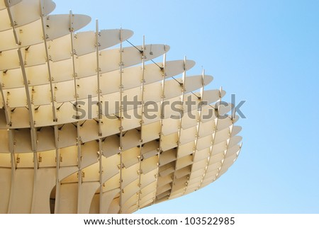 SEVILLE, SPAIN - MAY 9: Detail of Metropol Parasol  on May 9, 2012 in Seville,Spain. J. Mayer H. architects, it is made from bonded timber with a polyurethane coating. - stock photo