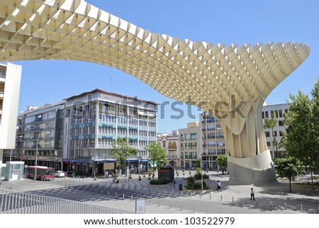 SEVILLE,SPAIN - MAY 9: Metropol Parasol in Plaza de la Encarnacion on May 9, 2012 in Seville,Spain. J. Mayer H. architects, it is made from bonded timber with a polyurethane coating. - stock photo