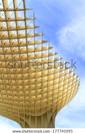 SEVILLE, SPAIN-MAY 09 2013: Metropol Parasol in Plaza de la Encarnacion. This large wooden structure designed by J. Mayer-Hermann is made from bonded timber with a polyurethane coating. - stock photo