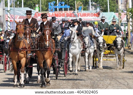 SEVILLE, SPAIN-MAY 4: People mounted on horse carriage on fair of Seville on May 4, 2011 in Seville - stock photo