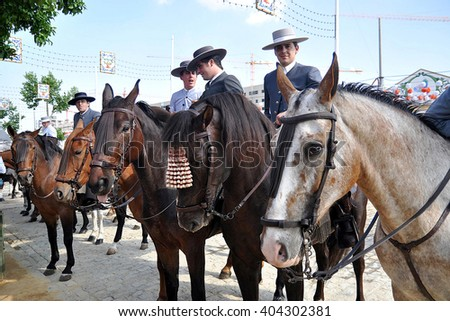 SEVILLE, SPAIN-MAY 4: People mounted on horse on fair of Seville on May 4, 2011 in Seville - stock photo