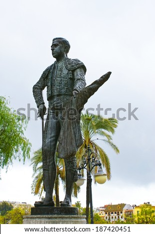 SEVILLE, SPAIN - MAY 3, 2013:  The bronzed statue of Pepe Luis Vazques was placed in front of the Plaza de Toros of the Real Maestranza, on May 3 in Seville. - stock photo
