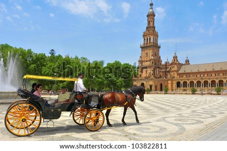 SEVILLE, SPAIN - MAY 17: View of Plaza de Espana on May 17, 2012 in Seville, Spain. Plaza de Espana complex, built in 1929, is a huge half-circle with a total area of 50,000 square meters - stock photo