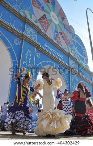 SEVILLE, SPAIN-MAY 4: Women dressed in flamenco dancing in Seville Fair. on May 4, 2011 in Seville - stock photo