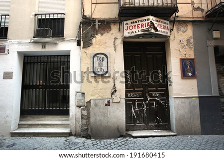 SEVILLE, SPAIN � NOVEMBER 4, 2010 � in the country's southern section of Andalucia is plagued with unemployment and decrepit buildings, despite efforts of small businesspeople. - stock photo