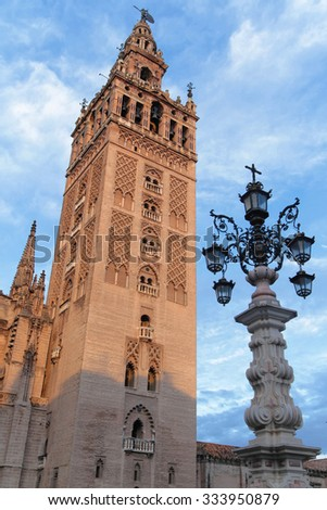 SEVILLE, SPAIN, October 20, 2015 : Giralda tower in the morning light. The bell tower of Seville Cathedral was originally built as a minaret during the Moorish period. - stock photo