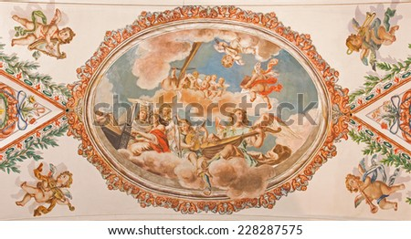 SEVILLE, SPAIN - OCTOBER 28, 2014: The fresco of angels with the music instruments on the ceiling in church Hospital de los Venerables Sacerdotes by Juan de Valdes Leal (1622 - 1690). - stock photo