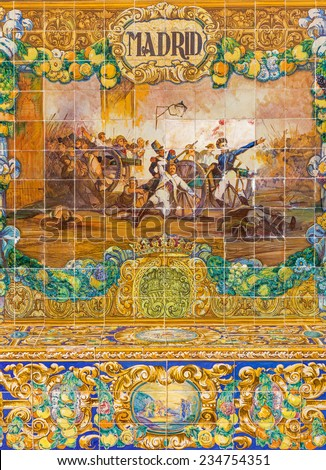 SEVILLE, SPAIN - OCTOBER 28, 2014: The Lugo as one of The tiled 'Province Alcoves' along the walls of the Plaza de Espana (1920s) by Domingo Prida with the war scene. - stock photo