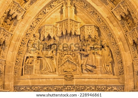 SEVILLE, SPAIN - OCTOBER 28, 2014: The Nativity scene on the Puerta San Miguel on the  Cathedral de Santa Maria de la Sede by Nicolas Martinez y Juan Norman from 15. cent.  - stock photo
