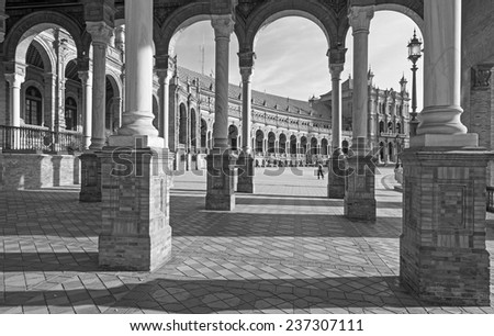 SEVILLE, SPAIN - OCTOBER 28, 2014: The portico of Plaza de Espana square designed by Anibal Gonzalez (1920s) in Art Deco and Neo-Mudejar style.