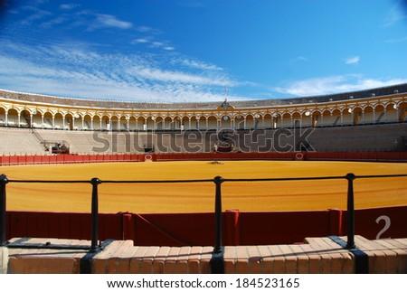SEVILLE, SPAIN - SEPTEMBER 25: Plaza de toros de la Real Maestranza de Caballeria de Sevilla on September 25, 2010, Spain. Also called Plaza de Toros of Seville, it is the oldest spanish bullring - stock photo