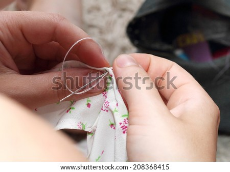 sew beautiful ladies blouse by hand - stock photo