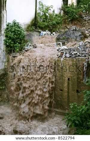 sewage water flowing into drain, rishikesh, india - stock photo