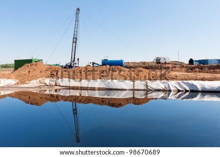 Sewage water generated during the drilling of oil wells in Russia - stock photo