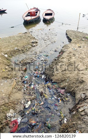 sewage water pollution channel to holy Ganges river In Varanasi, India - stock photo