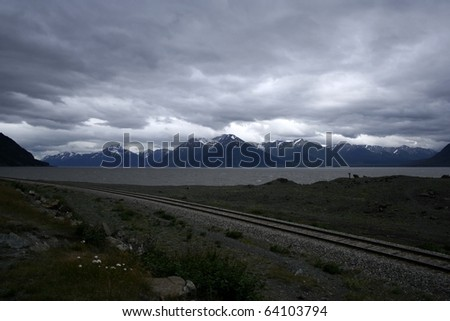 Seward Highway, The road from Anchorage to Seward on the part that goes next to the Turnagain Arm, on the far side the Kenai Mountains. Taken at Seward Highway, Kenai Peninsula, Alaska, USA. - stock photo