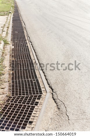 sewer by footpath - stock photo