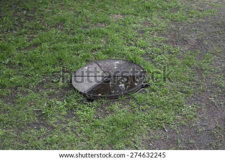 Sewer hatch with metal lid. - stock photo