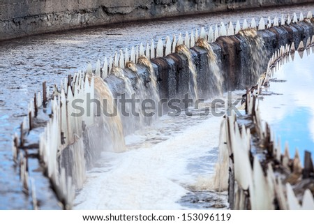 Sewer overflowing from round settlers, long exposure - stock photo
