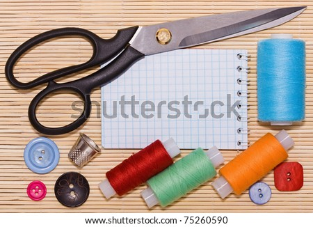 Sewing accessories. An empty place for your text. - stock photo