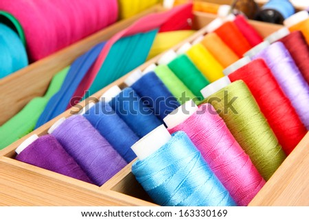 Sewing accessories in wooden box close up - stock photo