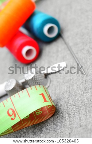 Sewing accessories on a fabric. - stock photo