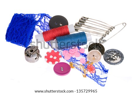Sewing accessories: threads, pins, buttons, hook, lace - stock photo