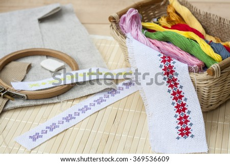 Sewing and embroidery craft kit, embroidery thread in basket and other tools, selective focus - stock photo