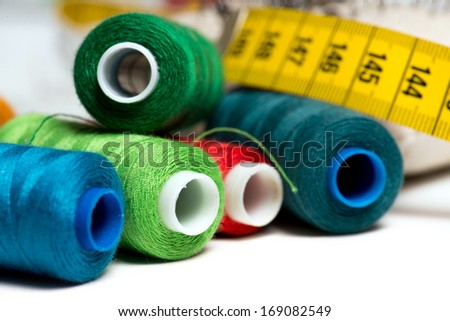 Sewing background with color threads and meter - stock photo