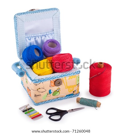 Sewing box with accessories isolated on white background - stock photo