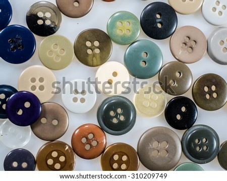Sewing buttons in different colors  - stock photo