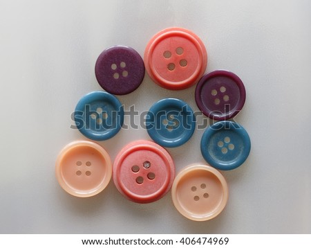 Sewing buttons, Plastic buttons, Colorful buttons on white background, Buttons close up .